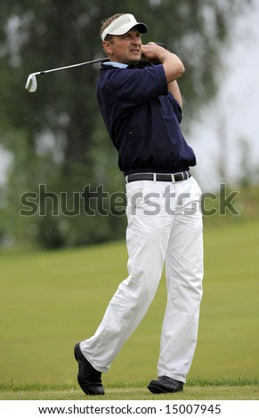 a golfer holding his finish after a good shot