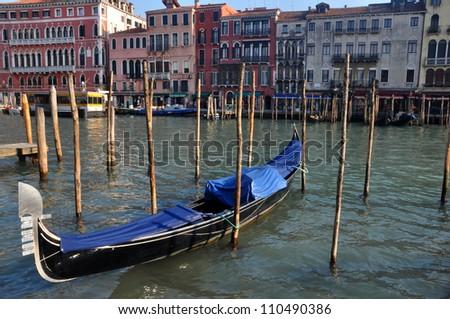 A Gondola moored in Venice - stock photo