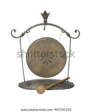 A gong hanging from a frame makes a resonating sound when struck with a striker - path included