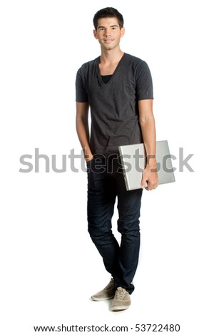 A good looking man holding his laptop and standing against white background - stock photo