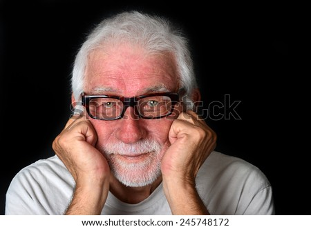 A good looking senior man with a friendly smile on his face looking directly into the camera - stock photo