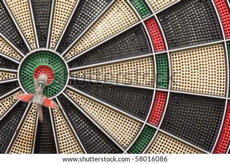 a good shot of a dart at a target - stock photo
