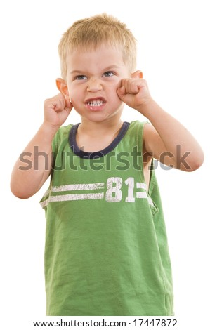 A gorgeous little cute three year old boy doing an angry facial expression, isolated on white.