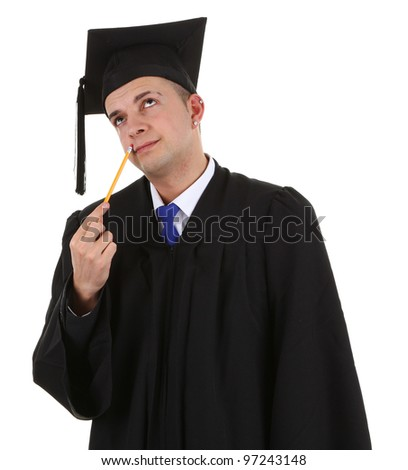 A graduate in thought with a pencil - stock photo