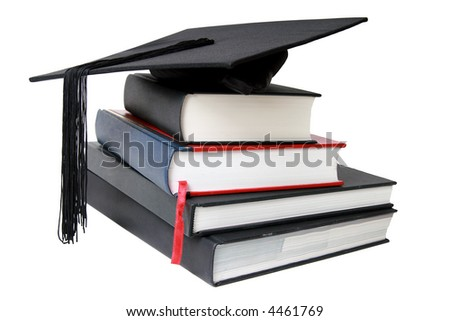 A Graduation mortar on top of books - stock photo