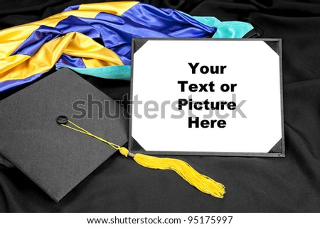 A graduation setting with cap,tassel, gown, hood and blank diploma for designers to place copy. - stock photo