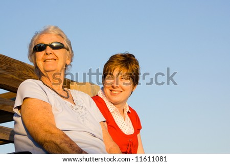 a grand mother and granddaughter enjoy the sun together