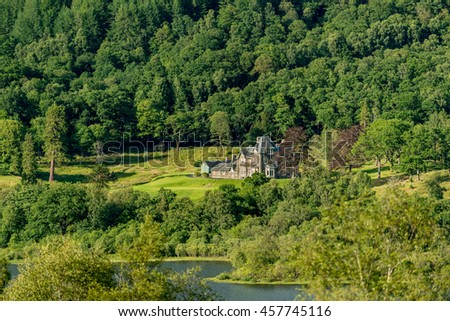 A grand stone house on the banks of Loch Archay, Trossachs National Park, Stirling District, Scotland, United Kingdom