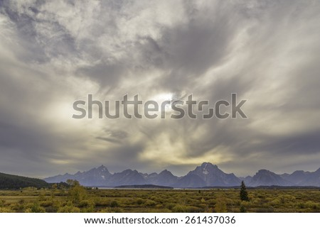 A Grand Teton National Park landscape on a cloud covered day in autumn.