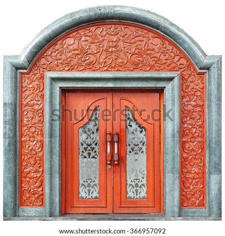 A grand vintage timber door with floral ornate carving.  - stock photo