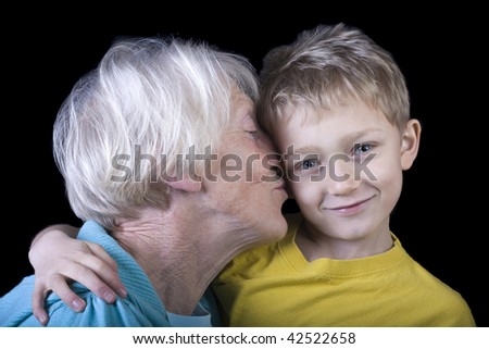 a grandchild reluctantly gives in to a kiss from grandma