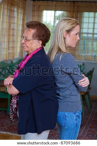 a grandson and his grandmother at the fight. conflict between generations - stock photo