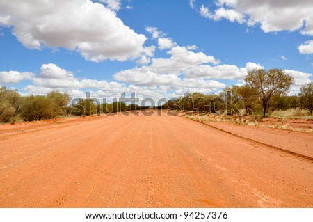 A gravel Road in the Australian Outback - stock photo