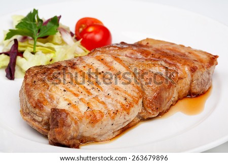 A great beef steak with vegetables on the plate. Close up. - stock photo