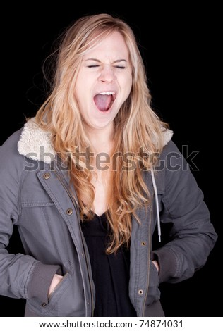 A great photograph of a girl yawning or yelling.