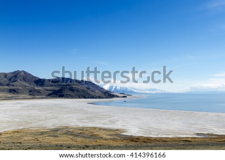 A great view of the Salt Lake in Utah-USA, as Background the Wasatch Mountains with snow over them - stock photo