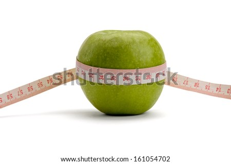 A green apple and a measuring tape isolated on white background