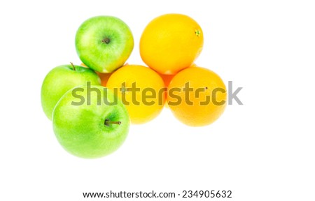 A green Apple In Front of Oranges and green apples  - stock photo