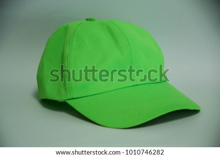 a green baseball cap on a white background