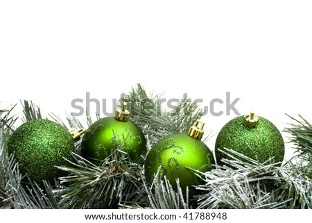 A green garland border with Christmas balls isolated on a white background, garland border - stock photo