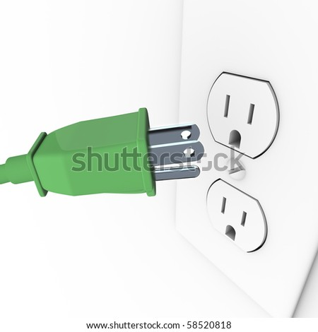 A green heavy duty electrical plug connects to a wall outlet - stock photo