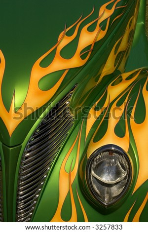 A green hot rod with yellow flames. - stock photo