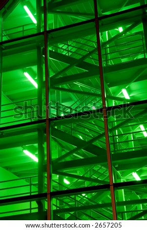 A green-illuminated stairwell from the Montreal Convention center - stock photo