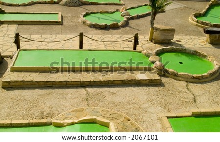 A green minigolf course. - stock photo