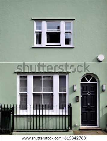 A Green Painted Facade In An Old Terrace Of Chelsea Houses, London, UK.