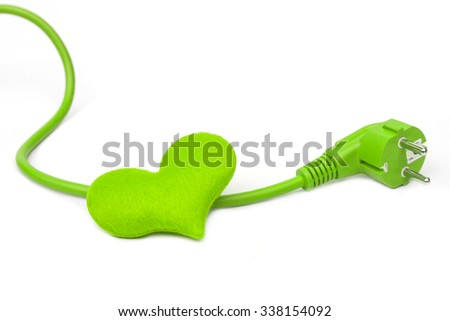 a green plug with a green heart / Green Energy concept - stock photo