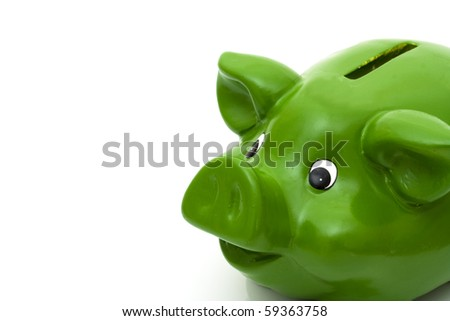 A green smiling piggy bank isolated on white, Happy with your finances - stock photo