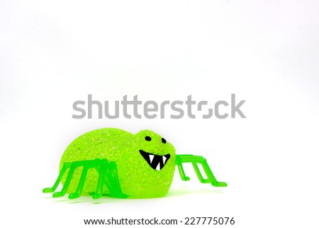 A green spider made from tiny plastic crystals - stock photo