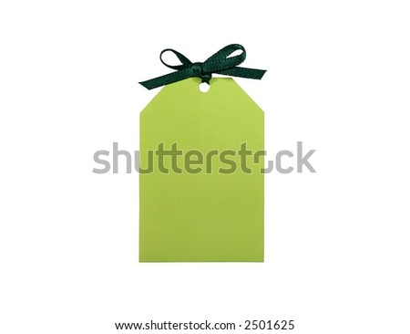 A green tag with dark green bow. - stock photo