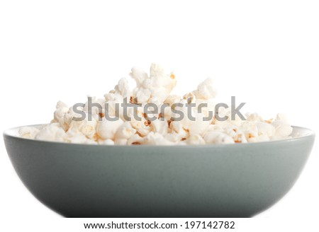 A grey bowl full of freshly popped popcorn.