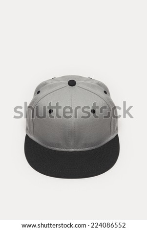 A grey cap top-side view isolated white background. - stock photo