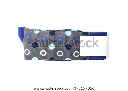 A grey cotton socks with empty(blank) label, circle pattern on the bottom isolated white.  - stock photo