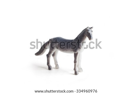 A grey horse plastic toy for kids isolated on white background