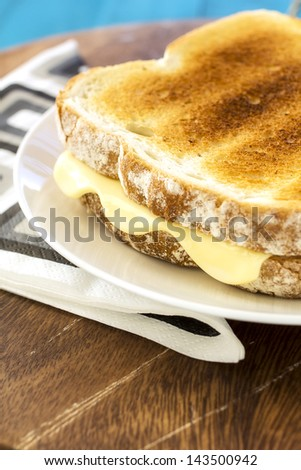 A grilled cheese sandwich, crispy on the outside - stock photo