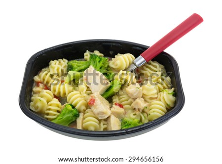 A grilled chicken with spiral noodles and broccoli in tray with red handle fork in food. - stock photo