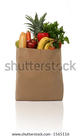 A grocery bag full of groceries - stock photo