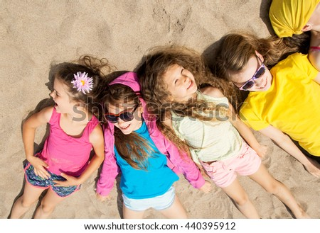 A group happy kids playing at the beach