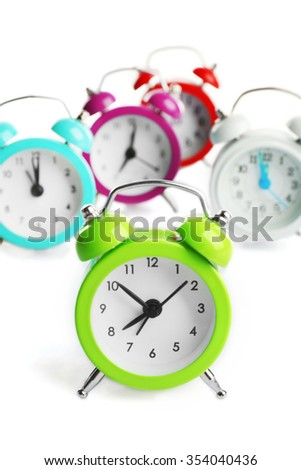 A group of alarm clocks, isolated on white