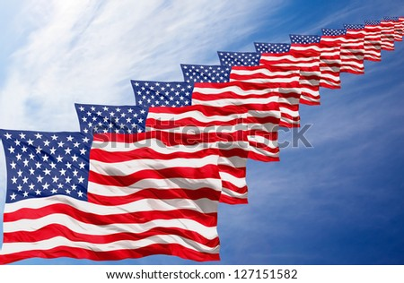 a group of american flag on a blue sky