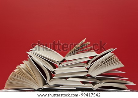 A group of books on red background - stock photo