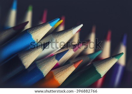 A group of brightly coloured pencils with a soft vintage filter added for effect - stock photo