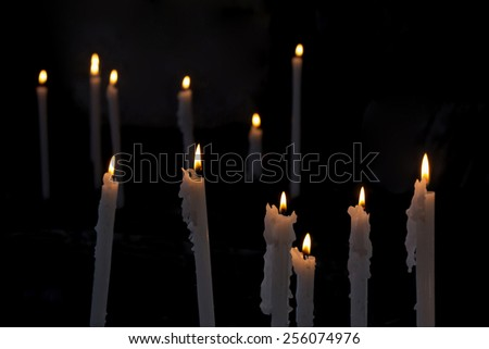 A group of burning candles in the church - stock photo