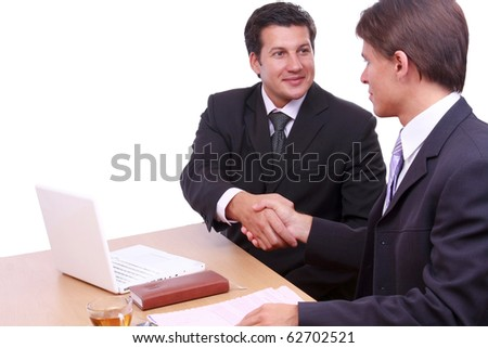 a group of business men working together at a meeting - stock photo