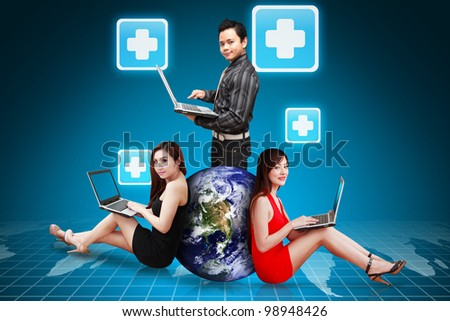 A group of Business team present the First Aid icon : Elements of this image furnished by NASA - stock photo