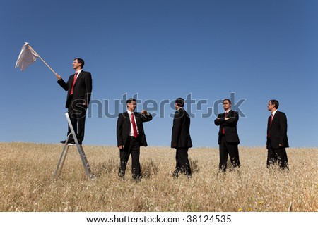a group of businessman in the field getting in line for there time to surrendering