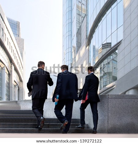 A group of businessmen in the business center. Urban scene. - stock photo